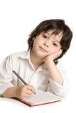 De kleine jongen wat tekening stock foto