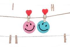De klem van de hartvorm op een streng, hangend Smiley Face-PAAR stock foto