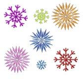 De klemkunst van regenboogsneeuwvlokken op wit Stock Afbeeldingen