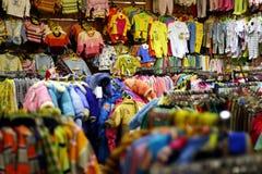 De kleren van babys Stock Foto's