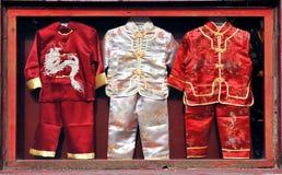 De kleren van Chinese kinderen Stock Foto