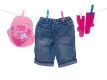 De kleren van de baby Stock Foto's