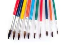 De kleur borstelt het schilderen kunstreeks stock foto's