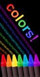 De kleuren van het kleurpotlood over zwarte Stock Afbeeldingen
