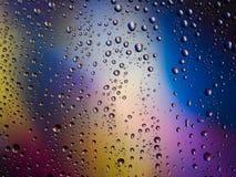 De kleuren van het van achtergrond waterdalingen de ruimteregenboog regenglas Royalty-vrije Stock Afbeelding