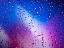 De kleuren van het van achtergrond waterdalingen de ruimteregenboog regenglas Royalty-vrije Stock Foto's