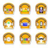 De kleurenmuziek plaatste hoofdtelefoon 9 met gadget Stock Foto