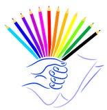 De kleurenpotloden van het handvol Stock Foto