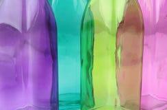 De kleurrijke achtergrond van de glasfles Stock Afbeeldingen