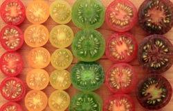 De kleurrijke achtergrond van de kersentomaat Stock Afbeeldingen