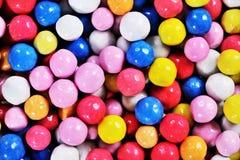 De kleurrijke achtergrond van het banketbakkerij Kleurrijke suikergoed Stock Fotografie