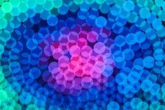 De kleurrijke achtergrond van het kleuren lichte onduidelijke beeld bokeh uit nadruk Royalty-vrije Stock Afbeeldingen