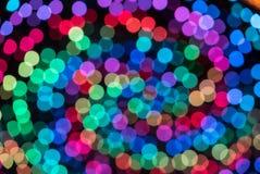 De kleurrijke achtergrond van het kleuren lichte onduidelijke beeld bokeh uit nadruk Royalty-vrije Stock Fotografie