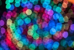 De kleurrijke achtergrond van het kleuren lichte onduidelijke beeld bokeh uit nadruk Royalty-vrije Stock Foto