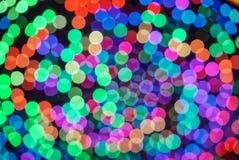 De kleurrijke achtergrond van het kleuren lichte onduidelijke beeld bokeh uit nadruk Stock Fotografie