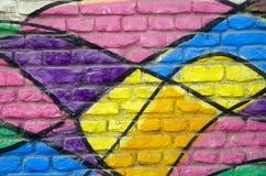 De kleurrijke geschilderde achtergrond van de huisbakstenen muur royalty-vrije stock foto's
