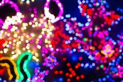 De kleurrijke Kerstmislichten, kunnen als achtergrond gebruiken Stock Foto's