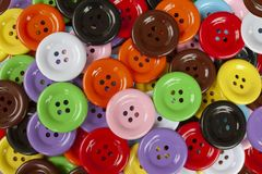 De kleurrijke Knoop is een apparaat voor de naad van de stof stock afbeelding