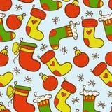 De kleurrijke naadloze achtergrond van Kerstmiskousen Royalty-vrije Stock Foto