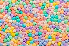 De kleurrijke pastelkleur van hart gevormde parels op witte achtergrond, gebruikt a Royalty-vrije Stock Afbeelding