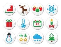 De kleurrijke pictogrammen van de Kerstmiswinter die als ronde etiketten worden geplaatst Stock Foto's