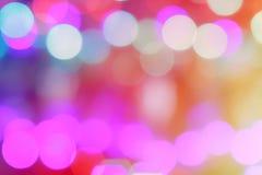 De kleurrijke samenvatting vertroebelde cirkelbokehlicht van de straat van de nachtstad voor achtergrond grafisch ontwerp en webs Royalty-vrije Stock Foto's