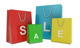 De kleurrijke shoping zakken en tekst van de VERKOOP Royalty-vrije Stock Afbeeldingen