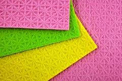 De kleurrijke sponsen van de schotelwas Stock Afbeeldingen