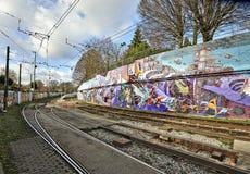De kleurrijke stedelijke kunst van de graffitistraat Stock Foto