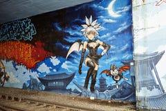 De kleurrijke stedelijke kunst van de graffitistraat Stock Afbeeldingen