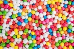 De kleurrijke textuur als achtergrond met suikersuikergoed bestrooit punt royalty-vrije stock afbeeldingen