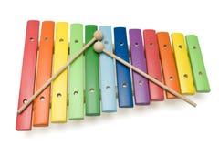 De kleurrijke xylofoon van het stuk speelgoed, die met het knippen van pa wordt geïsoleerde Royalty-vrije Stock Fotografie