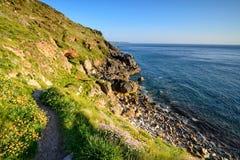 De klippen in Porth nanven in Cornwall Royalty-vrije Stock Fotografie