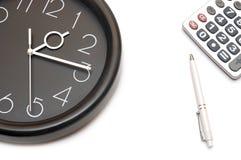 De klok en de calculator van de muur Royalty-vrije Stock Fotografie