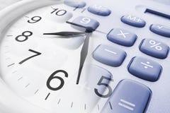De Klok en de Calculator van de muur Royalty-vrije Stock Foto