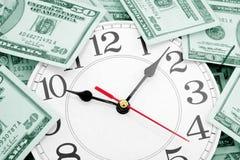 De klok en de dollars van de muur Royalty-vrije Stock Afbeelding