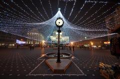 De klok van de binnenstad in Kerstmistijd - Timisoara Stock Foto