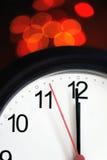 De klok van het bureau ongeveer om middernacht te tonen Royalty-vrije Stock Afbeelding
