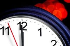 De klok van het bureau ongeveer om middernacht te tonen Royalty-vrije Stock Foto