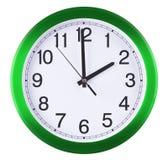 De klok van de muur die op witte achtergrond wordt geïsoleerd Twee uur stock foto
