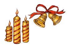 De klokken en de kaarsen van Kerstmis Stock Foto