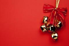 De Klokken van Kerstmis op de Rode Achtergrond Stock Foto