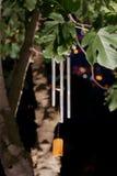 De klokkengelui van de wind bij nacht Stock Foto