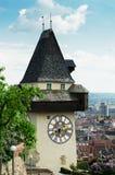 De klokketoren Uhrturm van Graz Stock Foto's