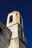 De klokketoren van de kerk, Yunquera, Spanje. Royalty-vrije Stock Afbeeldingen