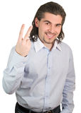 De knappe kerel telt op zijn geïsoleerder vingers twee Royalty-vrije Stock Foto