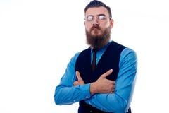 De knappe mens met een baard kleedde zich in een blauw overhemd royalty-vrije stock foto