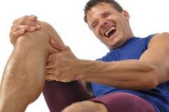 De knie en verlamt verwonding Stock Foto's