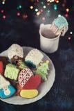 De koekjes en de kop thee van Kerstmis Stock Fotografie
