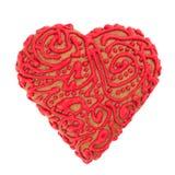 De koekjes van het zandkoekdeeg in de vorm van een hart, met rood suikerglazuur wordt verfraaid dat royalty-vrije stock foto